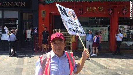 Peter Ren, owner of the New China restaurant, attends a protest in London's Chinatown on Tuesday.