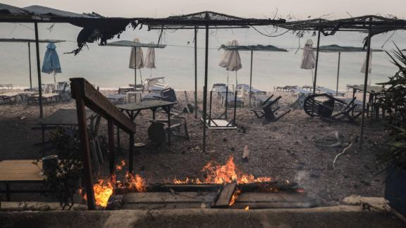 A fire smolders at a beach facility in Kineta.