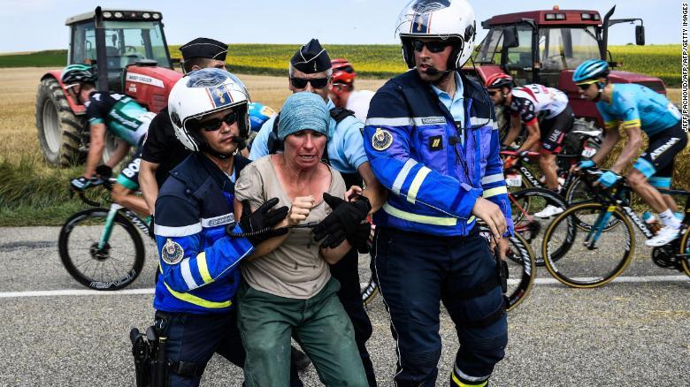 Gendarmes detain a protesting farmer.