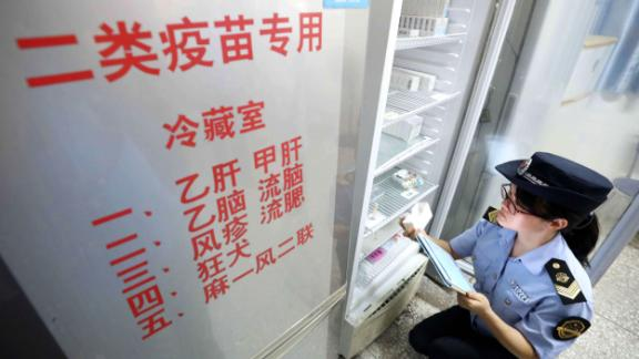 A local market supervisory authority official checks on vaccines at a hospital in Rongan in China