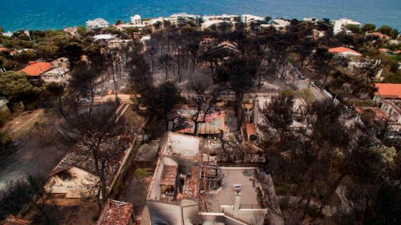 An aerial view shows burned-out houses in Mati.