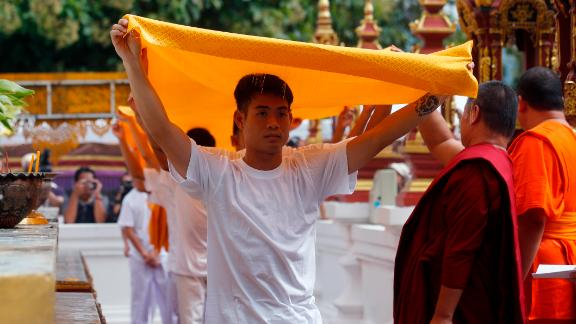 Soccer coach Ekkapol Chantawong, front, and members of the rescued soccer team attend a Buddhist ceremony on July 24.