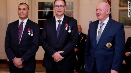 Australian members of the Thai cave rescue team, Craig Challen, left, and Dr. Richard Harris, center, at a function at Government House in Canberra, Australia on July 24.