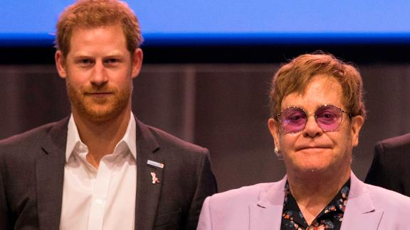 Sir Elton John (m), Harry, Duke of of Sussex (l) and Nelson Mandela
