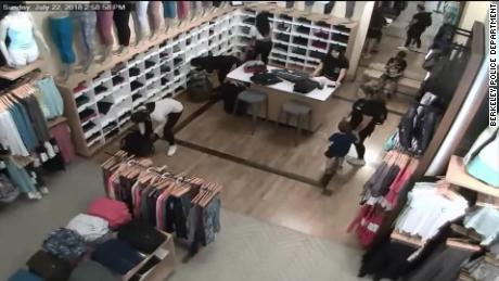 Surveillance video shows three women taking leggings and yoga pants from a Lululemon store in Fresno on Sunday.