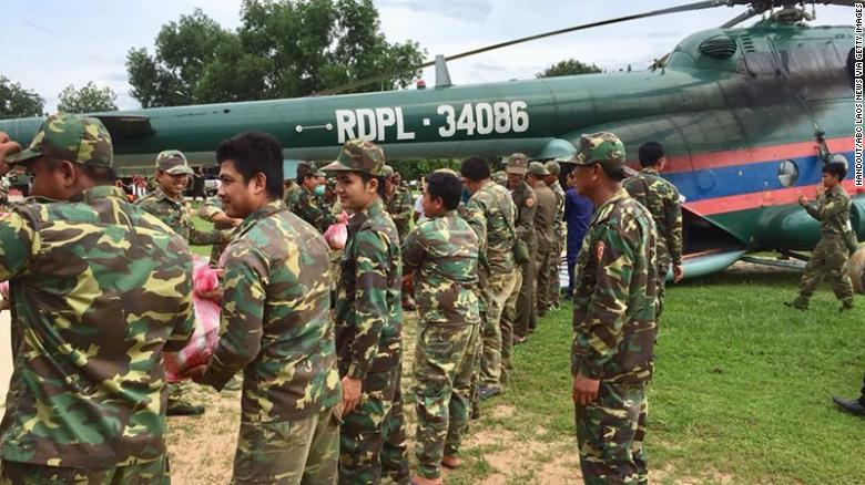 Laotian military forces prepare for rescue efforts after the dam collapse.