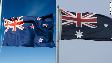 New Zealand's flag, left, and Australia's flag.