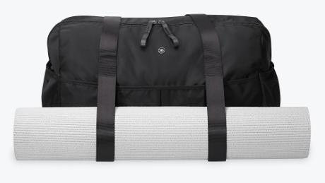 b6adc02d8f3 ... clothes but has additional straps to stow away a yoga mat. This was exactly  the predicament I found myself in, so I gave Gaiam's Warrior Weekender Bag  ...