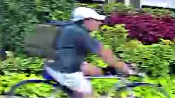 This surveillance image shows a suspect in the shooting of Dr. Mark Hausknecht, police say.