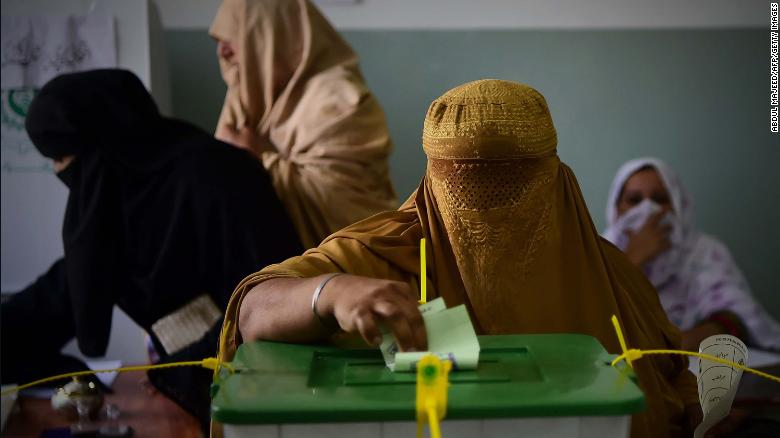 A woman casts her vote during Pakistan's general election at a polling station during the general election in Pehawar.