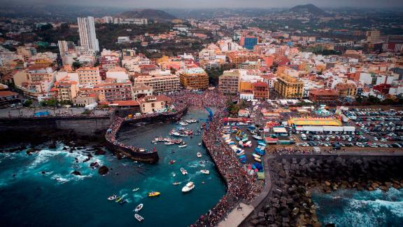 Puerto de la Cruz, Tenerife, Spain: This drone image shows the Virgen del Carmen festival that honors the patron saint of fishermen on the Spanish island of Tenerife. Local residents take a statue of the Virgen del Carmen on board an adorned boat and sail it along the coast.