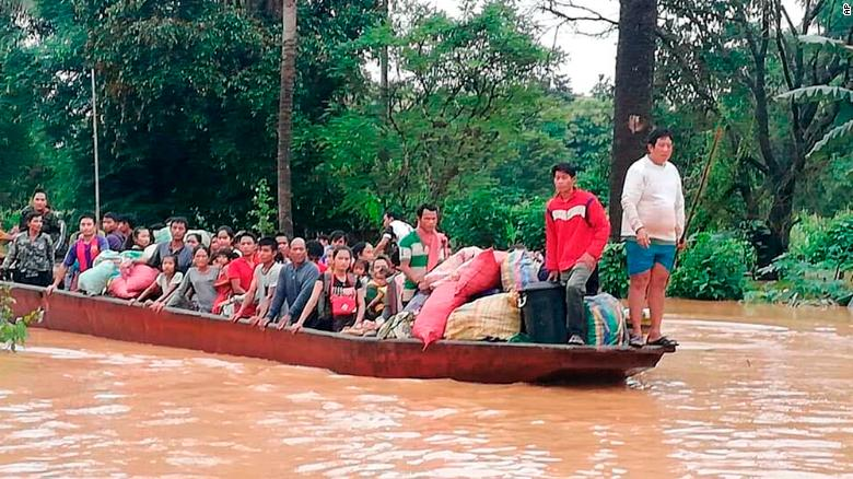 Residents evacuate on boats after the Xepian Xe Nam Noy dam burst in Attapeu province on Tuesday.