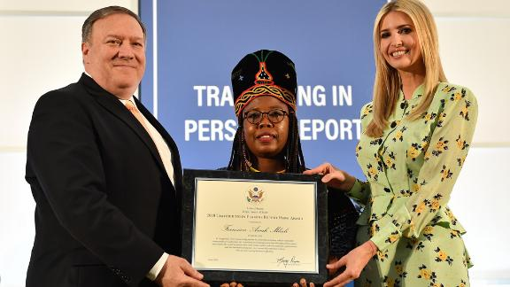 Secretary of State Mike Pompeo, joined by Advisor to the President Ivanka Trump, presents a certificate to 2018 'TIP Report Hero' Francisca Awah Mbuli of Cameroon. Francisca Awah Mbuli is one of ten individuals from around the world who was recognized for her efforts to fight against human trafficking, at the U.S. Department of State on June 28, 2018.