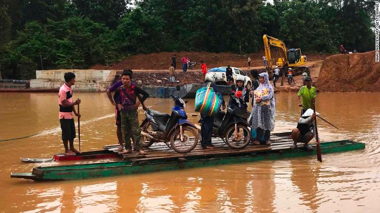 People use a makeshift ferry to cross the swollen Xe Khong Rver due to flash flooding Wednesday. cambodia to evacuate 25,000 people downstream of collapsed laos dam Cambodia to evacuate 25,000 people downstream of collapsed Laos dam 180725163904 09 laos dam collapse 0725 exlarge 169