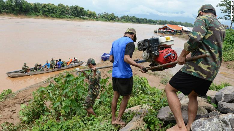 Laotian soldiers carry rescue equipment Wednesday in Attapeu province. cambodia to evacuate 25,000 people downstream of collapsed laos dam Cambodia to evacuate 25,000 people downstream of collapsed Laos dam 180725164055 10 laos dam collapse 0725 restricted exlarge 169