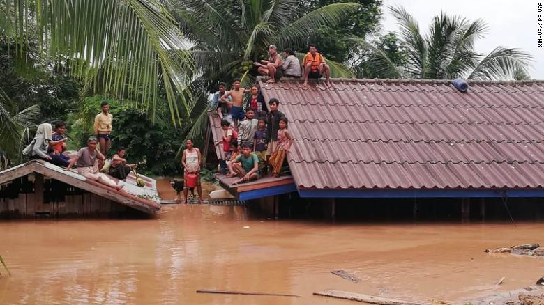 People are stranded on rooftops Tuesday after a dam under construction collapsed in Laos. cambodia to evacuate 25,000 people downstream of collapsed laos dam Cambodia to evacuate 25,000 people downstream of collapsed Laos dam 180725164158 11 laos dam collapse 0724 restricted exlarge 169