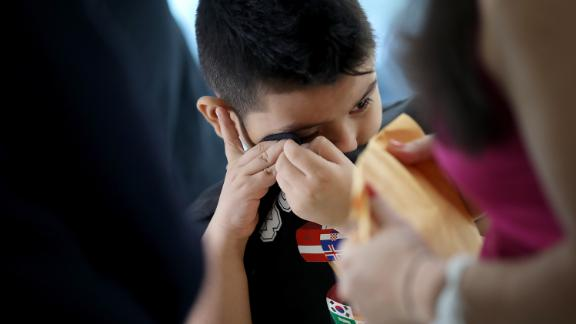 Seven-year-old Andy is reunited with his mother, Arely, at Baltimore-Washington International Airport July 23, 2018 in Linthicum, Maryland.