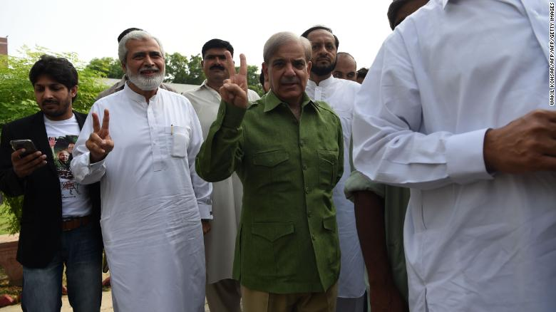 Shahbaz Sharif stands in a queue before casting his vote.