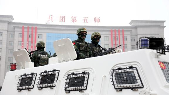 BORTALA, CHINA - MARCH 08:  Officers and soldiers of Xinjiang Production and Construction Corps patrol during a pep rally for the anti-terrorism and maintaining stability at Shuanghe on March 8, 2017 in Bortala Mongol Autonomous Prefecture, Xinjiang Uighur Autonomous Region of China. Over 1,500 officers and soldiers of armed police, public security police, militia, joint defense force and other forces of Xinjiang Production and Construction Corps participated in a pep rally for the anti-terrorism and maintaining stability on Wednesday in Shuanghe, Xinjiang.  (Photo by VCG/VCG via Getty Images)