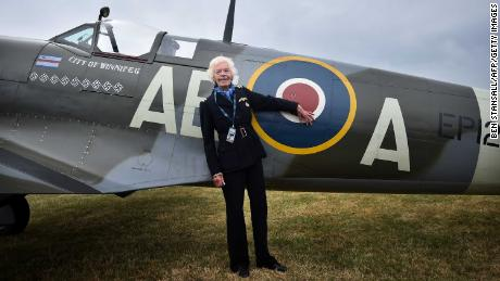 Battle of Britain veteran, pilot First Officer Mary Ellis, poses with a Spitfire aircraft at Biggin Hill airfield in Kent, on August 18, 2015.