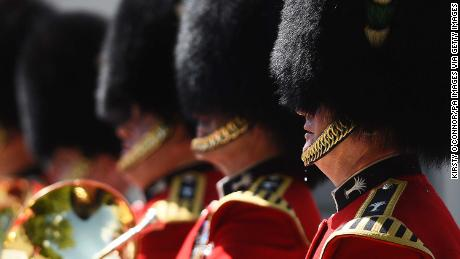 A bead of sweat falls from a member of the Queen's Guard during the changing of the guard at Wellington Baracks in London.