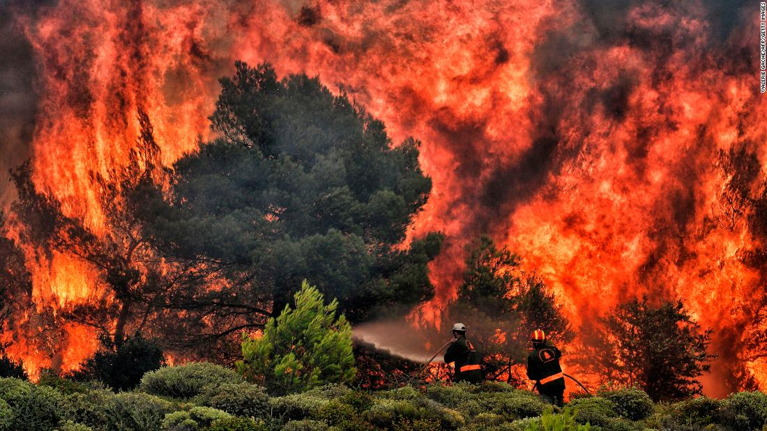 "Firefighters try to extinguish wildfire flames in Kineta, Greece, on Tuesday, July 24. Dozens of people have been killed in <a href=""https://www.cnn.com/2018/07/24/world/gallery/greece-wildfires-july-2018-intl/index.html"" target=""_blank"">the wildfires</a> -- the worst to affect Greece in over a decade."