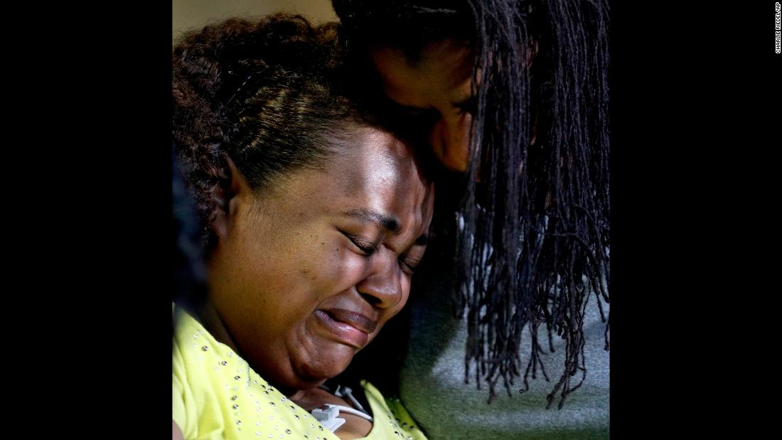 "Tia Coleman, left, is comforted by her sister, Leeta Bigbee, after speaking to the media at a hospital in Branson, Missouri, on Saturday, July 21. Coleman survived the sinking of a duck boat but lost nine family members in <a href=""https://www.cnn.com/2018/07/24/us/missouri-duck-boat-investigation/index.html"" target=""_blank"">the accident.</a> Seventeen people were killed in all."