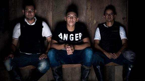Ramón Bedoya is surrounded by bodyguards at his family's farm in western Colombia in April.