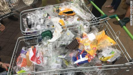 Trolleys full of plastic packaging. Alex Morss estimates around half of the packaging they see isn't recyclable.