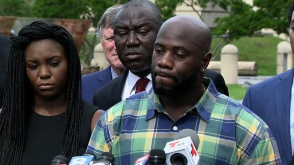 Michael McGlockton speaks about the death of his son, Markeis McGlockton, Thursday in Clearwater, Florida. Behind him is attorney Benjamin Crump; at left is Markeis' girlfriend, Britany Jacobs.
