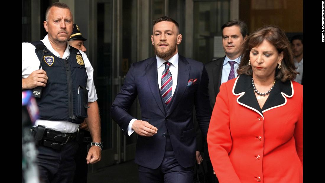 "MMA star Conor McGregor arrives to talk to the media after he pleaded guilty Thursday, July 26, to a violation of disorderly conduct. He had been originally charged with multiple counts of assault and criminal mischief after <a href=""https://www.cnn.com/2018/04/05/sport/conor-mcgregor-wanted-nypd/index.html"" target=""_blank"">attacking a bus filled with UFC fighters</a> in April. As part of his plea deal, he must undergo anger-management counseling and fulfill five days of community service."