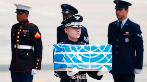 A soldier carries a casket containing the remains of a US soldier killed during the 1950-53 Korean War, after arriving from North Korea at Osan Air Base in Pyeongtaek on July 27, 2018. - A US military aircraft carrying the remains of US Korean War dead collected in North Korea arrived in the South on July 27, the 65th anniversary of the armistice that ended the fighting. (Photo by KIM HONG-JI / POOL / AFP)        (Photo credit should read KIM HONG-JI/AFP/Getty Images)