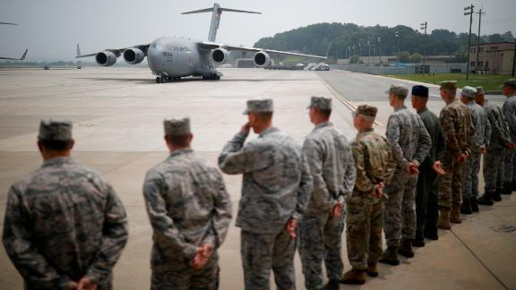 A US cargo aircraft carrying the remains of 55 US soldiers killed during the 1950-53 Korean War, arrives from North Korea at Osan Air Base in Pyeongtaek on July 27, 2018. - A US military aircraft carrying the remains of US Korean War dead collected in North Korea arrived in the South on July 27, the 65th anniversary of the armistice that ended the fighting. (Photo by KIM HONG-JI / POOL / AFP)        (Photo credit should read KIM HONG-JI/AFP/Getty Images)