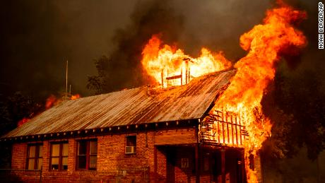 Flames devour a historic schoolhouse Thursday in Shasta, California.