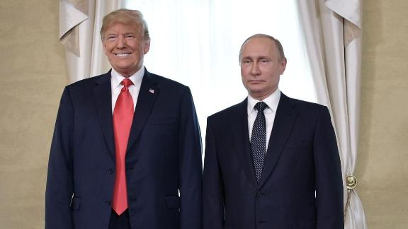"US President Donald Trump (L) and Russia's President Vladimir Putin pose ahead a meeting in Helsinki, on July 16, 2018. - The US and Russian leaders opened an historic summit in Helsinki, with Donald Trump promising an ""extraordinary relationship"" and Vladimir Putin saying it was high time to thrash out disputes around the world. (Photo by Alexey NIKOLSKY / Sputnik / AFP)        (Photo credit should read ALEXEY NIKOLSKY/AFP/Getty Images)"