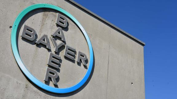 The picture taken on September 8, 2016 shows a sign with the logo at the headquarter of German chemical company Bayer in Leverkusen, western Germany.  US seeds and pesticides maker Monsanto is in talks with German chemicals giant Bayer over a possible merger of their two agrochemicals divisions. / AFP / PATRIK STOLLARZ        (Photo credit should read PATRIK STOLLARZ/AFP/Getty Images)