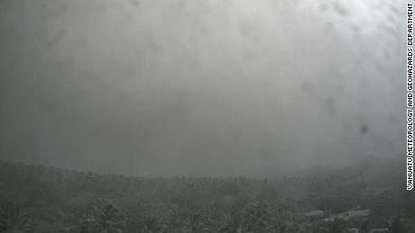 A shot from a government-run camera on Ambae shows the sky almost completely obscured by falling ash.