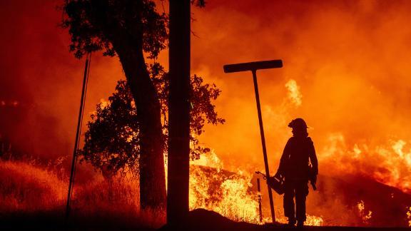 A firefighter battles the Carr fire in Redding, California.