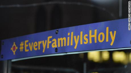 "A sign on a mirror outside the Christ Church Cathedral is part of the church's ""Every Family is Holy"" campaign."