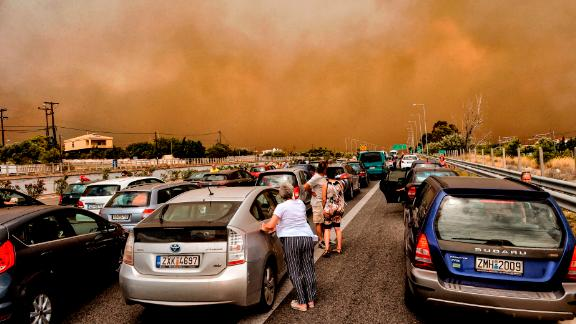 Cars are blocked after a wildfire caused a road closure in Kineta, Greece, on Monday, July 23.
