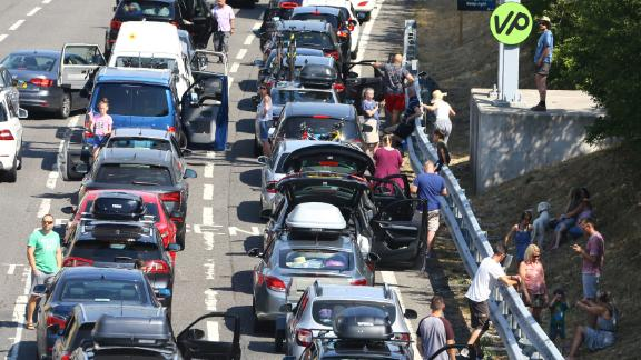 Traffic is backed up on the M20 motorway in England as people line up to get to the Eurotunnel in Folkestone, England, on Thursday, July 26. Passengers using the cross-Channel services were warned of delays of up to five hours after air-conditioning units failed on trains amid sizzling temperatures.