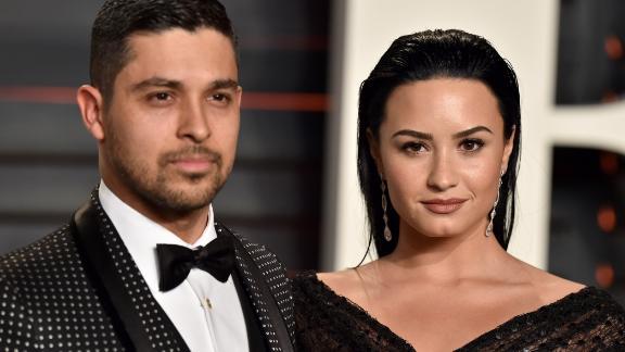 Wilmer Valderrama and singer Demi Lovato at the 2016 Vanity Fair Oscar Party