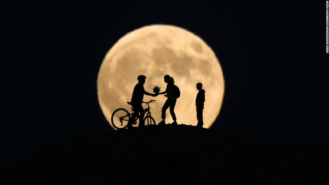 People's silhouettes can be seen in Van, Turkey, during the partial phase of the eclipse.