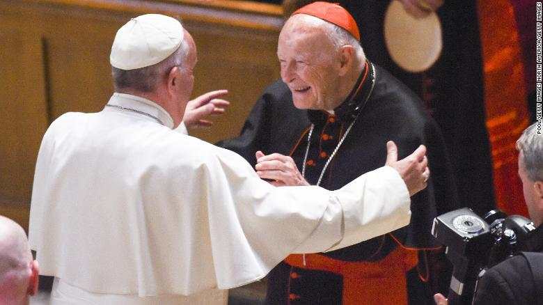 Theodore McCarrick, center, greets Pope Francis in 2015 at the Cathedral of St. Matthew in Washington.
