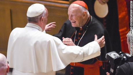 Theodore McCarrick, center, greets Pope Francis in 2015 at the Cathedral of St. Matthew in Washington