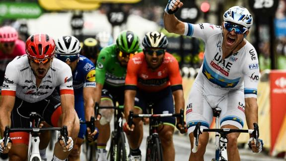 Norway's Alexander Kristoff celebrates as he crosses the finish line to win the 21st and last stage of the 105th edition of the Tour de France cycling race between Houilles and Paris Champs-Elysees.
