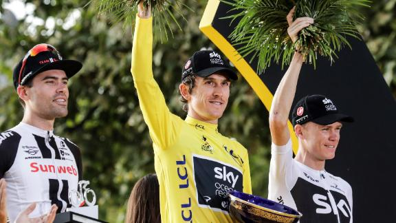 Geraint Thomas is flanked by second-placed Dutchman Tom Dumoulin and his Team Sky teammate Chris Froome on the podium in Paris.