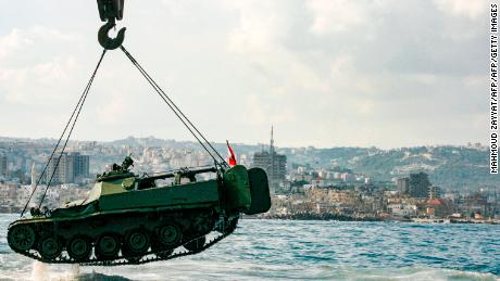 Environmentalists drop an old tank provided by the Lebanese Armed Forces into the Mediterranean Sea on July 28 to create new habitat for marine life.