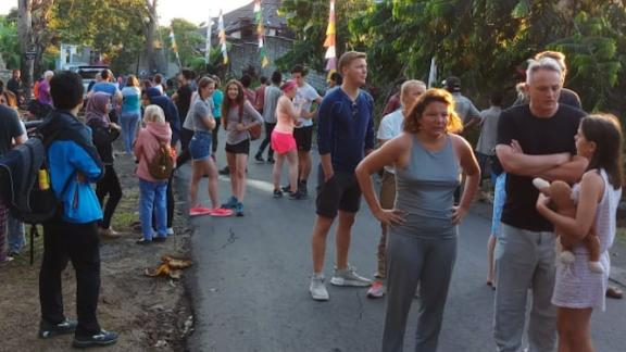 Tourists left stranded after buildings collapsed in the quake.