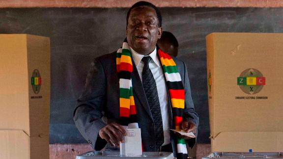 Zimbabwean President Emmerson Mnangagwa casts his vote for the presidential elections.